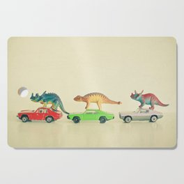 Dinosaurs Ride Cars Cutting Board