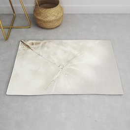 Sparkling dandelion seed head with droplet Rug
