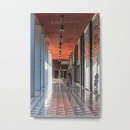 A woman from behind pushes a stroller under the arcades of the city Metal Print