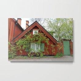Cute red wood Swedish house in the green  Metal Print