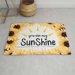 Many sunflowers in the light Rug