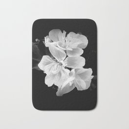 geranium in bw Bath Mat