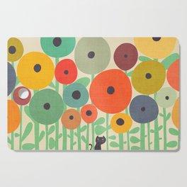 Cat in flower garden Cutting Board