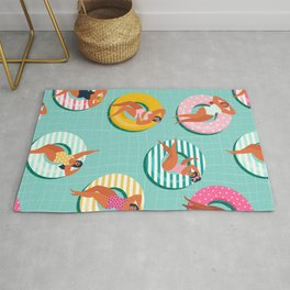 Summer gils on inflatable in swimming pool floats. Rug