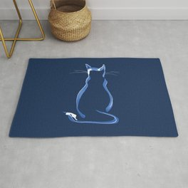 Sitting Cat from behind in Blue Rug