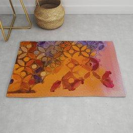 a piece of orange and purple Rug