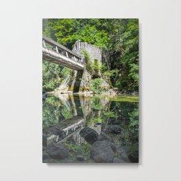 Pedestrian bridge crossing wild river with old mill building Metal Print