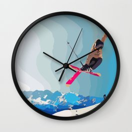 Man jumps with skies on piste with mountains and sky background Wall Clock