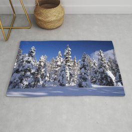 Snow covered trees in the forest. Winter day with blue sky. Rug