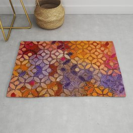 a piece of orange pink and peurple I Rug