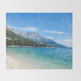 Blue Ocean Beach | Caribbean Island Clear Water Waves in Europe Mountain Landscape Beautiful Sky Throw Blanket