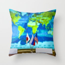 The flags of the countries representing the crew members of Expedition 28 are seen here at the Russi Throw Pillow