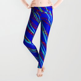 Many rays of light blue light with symmetrical bright waves on blue black. Leggings