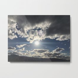 Sun glare in the beautiful cloudy sky Metal Print