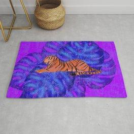 Resting graceful wild tiger and blue monstera leaves purple design.. Rug